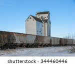 Grain Elevator and Annex with Train in Winter - stock photo