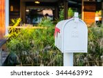 White Mail Box In Front Of A...
