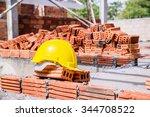 yellow hard hat on construction ... | Shutterstock . vector #344708522