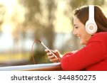 lady listening music from smart ... | Shutterstock . vector #344850275