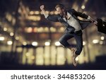 successful businessman jumping | Shutterstock . vector #344853206