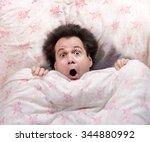 frightened man lying in bed.... | Shutterstock . vector #344880992
