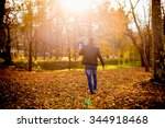 father carrying a toddler in a... | Shutterstock . vector #344918468