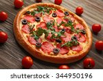 tasty pizza with salami... | Shutterstock . vector #344950196