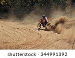 Motocross Racer Moves Along...