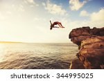 cliff jumping into the ocean at ... | Shutterstock . vector #344995025