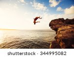cliff jumping into the ocean at ... | Shutterstock . vector #344995082