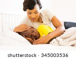 beautiful african mother... | Shutterstock . vector #345003536