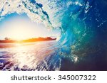 blue ocean wave crashing at... | Shutterstock . vector #345007322