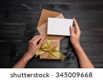 Female Hands Holding Gift Card...