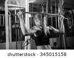 young muscular woman doing... | Shutterstock . vector #345015158