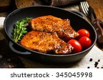 grilled pork chops in sweet... | Shutterstock . vector #345045998