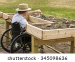man in a wheelchair working a... | Shutterstock . vector #345098636