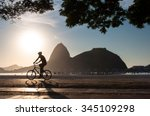 Silhouette Of A Man Cycling In...