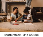 mixed race mother and daughter... | Shutterstock . vector #345120608