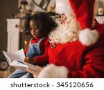 santa claus reading a book with ... | Shutterstock . vector #345120656