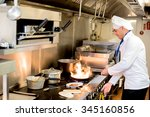 chef frying a dish in hotel...   Shutterstock . vector #345160856
