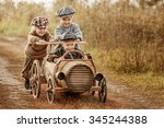 two young children ride in the... | Shutterstock . vector #345244388