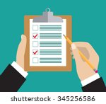 hand holding clipboard with... | Shutterstock .eps vector #345256586