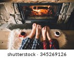 Bare Couple Feet By The Cozy...