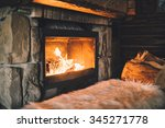 warm cozy fireplace with real... | Shutterstock . vector #345271778