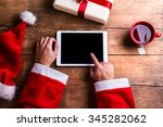 Santa Claus Holding Tablet In...