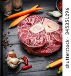 Small photo of Veal shank slices meat and ingredients for Osso Buco cooking, close up