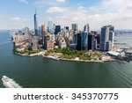 NEW YORK - AUGUST 24: Views of Midtown Manhattan from Liberty Island side on August 24, 2015. This park provides a beautiful view to the Manhattan skyline. - stock photo
