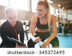 shot of a personal trainer... | Shutterstock . vector #345372695