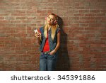 young woman standing at the... | Shutterstock . vector #345391886