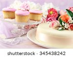 cake with sugar paste flowers... | Shutterstock . vector #345438242