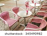pink plastic wicker chairs and... | Shutterstock . vector #345490982