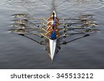 rowers paddling in a beautiful... | Shutterstock . vector #345513212