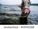fly fishing taking line | Shutterstock . vector #345542288