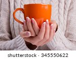 Woman Holds A Winter Cup Close...