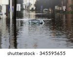 a flooded car in deep water. | Shutterstock . vector #345595655