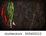 herbs and spices over old wood... | Shutterstock . vector #345603212