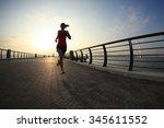 runner athlete running at... | Shutterstock . vector #345611552