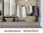 modern closet with row of white ... | Shutterstock . vector #345625022