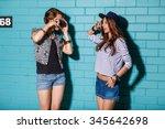 best friends hipster girls... | Shutterstock . vector #345642698