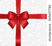 shiny holiday red satin ribbon... | Shutterstock .eps vector #345657782