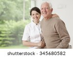 young nurse taking care of old... | Shutterstock . vector #345680582