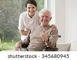Old Man On Wheelchair Holding...