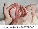 Mother Hold Feet Of Newborn...
