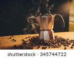 Italian coffee maker and coffee beans on canvas background - stock photo