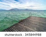 ducks on pier with cloudy sky... | Shutterstock . vector #345844988
