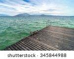 ducks on pier with cloudy sky... | Shutterstock . vector #345844988