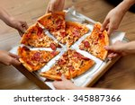 Small photo of Eating Food. Close-up Of People Hands Taking Slices Of Pepperoni Pizza. Group Of Friends Sharing Pizza Together. Fast Food, Friendship, Leisure, Lifestyle.
