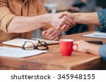 sealing a deal. close up of two ... | Shutterstock . vector #345948155