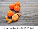 tangerines on old wooden table | Shutterstock . vector #345951965